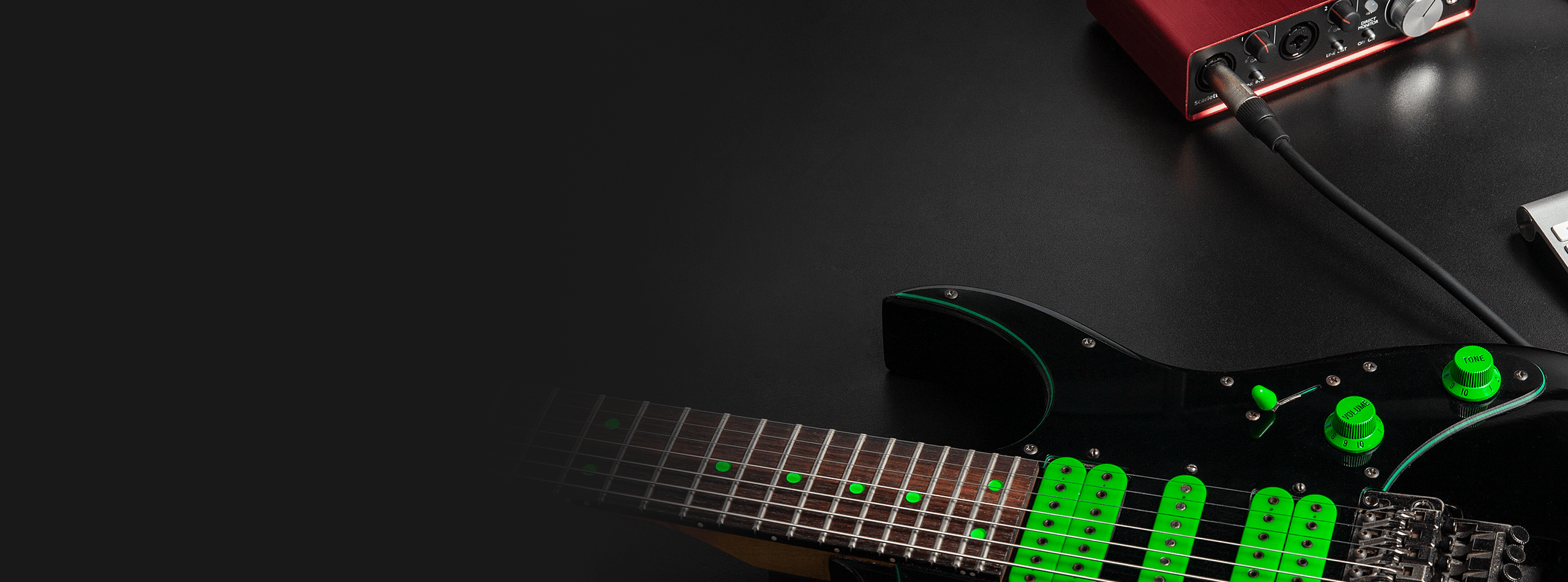 7-string Guitar and recording interface on a desk